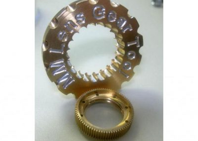 Brass camera drive gear and gear mounting tool for Inuktun.