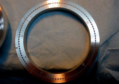 """4"""" stainless steel part 1/2 thou concentric and 20 thou holes +- 2/10ths of a thou."""